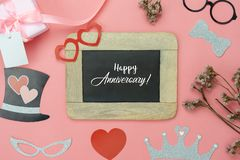 Table top view aerial image of sign anniversary day background concept. Photo booth props on modern grunge pink wallpaper at home office desk studio.Space for royalty free stock photo