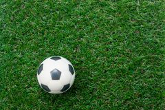 Table top view aerial of soccer or football world cup season background. Flat lay objects football on the artificial green grass wallpaper.Free space for Royalty Free Stock Image