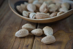 Table top view on almonds in bowl Stock Image