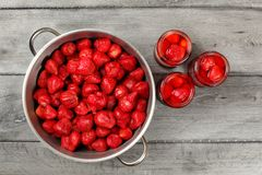 Table top view - homemade strawberry compote preparation. Metal royalty free stock images
