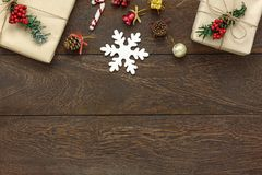 Table top view of the Merry Christmas & Happy new year concept. Background.Essential festive decorations on modern brown wood.Copy space for creative text or royalty free stock photo