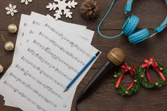 Table top view of music sheet note and accessories Merry Christmas & Happy new year concept. stock photo