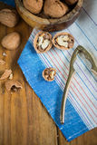 Table top view on nut cracker and open walnut Stock Image