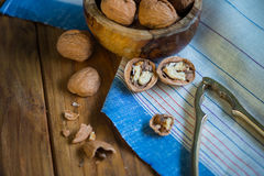 Table top view on nut cracker and open walnut Stock Photos