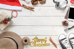 Table top view of ornaments and decorations Merry Christmas and Happy New Year. With accessory travel concept background.Essential item on modern rustic white stock photos