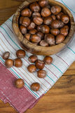 Table top view over bowl with hazelnuts Royalty Free Stock Photo