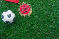 Table top view of soccer or football world cup season background. Flat lay objects gold medal & ball on the artificial green grass wallpaper.Copy space for Royalty Free Stock Photos