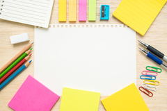 Table top view of stationery items  with empty line paper on woo Stock Image
