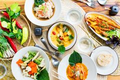 Table top view with Thai traditional cuisine. Table top view Thai traditional cuisine. Pad Pak Ruam Mitr Stir vegetables. Red curry chicken coconut soup. Pad Pak stock image