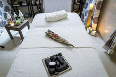 A massage room and spa treatments. free and empty room for massages and recovery of patients. stock photo