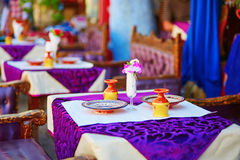 Table in traditional Moroccan street restaurant Royalty Free Stock Images