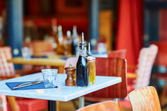 Table of traditional outdoor French cafe in Paris Royalty Free Stock Images