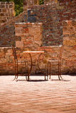 Table for Two. Table and chairs on a romantic stone balcony royalty free stock photos