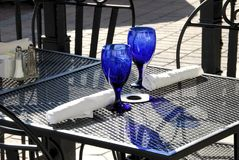 Table for Two. Outdoor table with place settings for two stock images