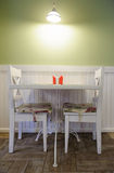 Table for two. In cozy cafe with pastel green walls Royalty Free Stock Photography
