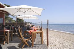 Table for two. Restaurant on the beach in French Riviera Royalty Free Stock Image