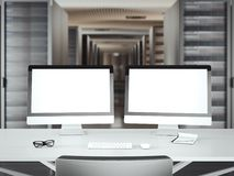 Table with two displays in a large server room. 3d rendering Royalty Free Stock Photo
