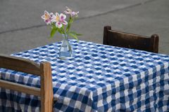 Table for two with bouquet stock image