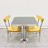 Table with two chairs in a cafeteria Stock Photo