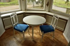 Table and two chairs at the living hall at Haus Hohe Pappeln stock photo