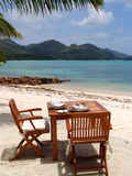 Table with two chairs at the ocean shore. In Seychelles, nature Stock Photos