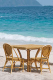 A table and two chairs at the shore Stock Photos