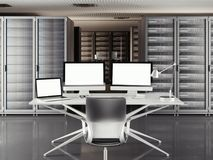 Table with two displays and laptop in a large server room. 3d rendering Stock Photo