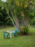 Table for two in a garden in Hawaii Stock Images