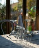 Table for two people with cutlery and wine glasses. In the evening sun stock photography