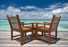 A table for two, please. Restaurant table over turquoise waters Stock Images