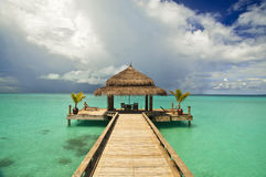 A table for two, please. Table at a luxury tropical resort, Maldives Royalty Free Stock Images