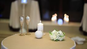 Table for two setup with glasses and candle stock video footage