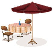 A table with an umbrella in a cafe Royalty Free Stock Photo