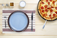 Table utensil  and pizza Stock Photo
