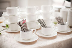Table utensils, spoon, fork, coffee cup. Table setting with utensils, spoon, fork, coffee cup Royalty Free Stock Images