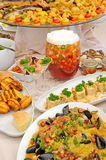 Table with variety of food Stock Photos