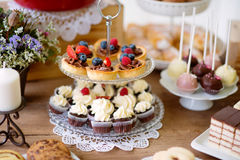 Table with various cookies, tarts, cakes, cupcakes and cakepops Royalty Free Stock Image