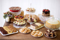 Table with various cookies, tarts, cakes, cupcakes and cakepops Stock Images