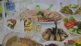 A table with various food. A close up of an appetizer spread full of various foods laid out on a restaurant table stock footage