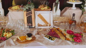 A Table With Various Food. A Close up of an Appetizer Spread Full of Various Foods Laid Out on a Restaurant Table stock video