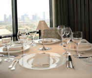 Table With A View. Elegant Dining Room/Restaurant overlooks the skyline of the city of Dallas. Elegant setting for lunch or dinner Royalty Free Stock Images