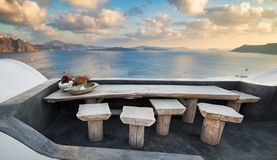 Table with view in Santorini, Greece stock image