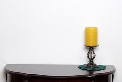 Table with a wax candle lamp Royalty Free Stock Photo