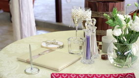 Table with wedding accessories and two glasses of champagne.  stock video