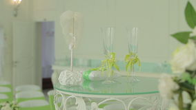 Table with wedding accessories and two glasses stock footage