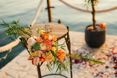 Table for the wedding ceremony, flower arrangement. Wedding deco. Rations. Wedding at the sea in Montenegro Stock Photo