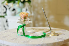 Table for wedding ceremony. The table for the wedding ceremony with a pen to sign the agreement and the decor of flowers Stock Photography
