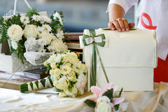 A table for wedding presents decorated with bouquets of roses Stock Photo