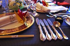 The table at a wedding reception. Tableware and utensils on the table at a wedding reception Stock Photography