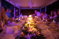 Table for wedding reception with candles on nature in evening. Table for a wedding reception with candles on the nature in the evening stock images